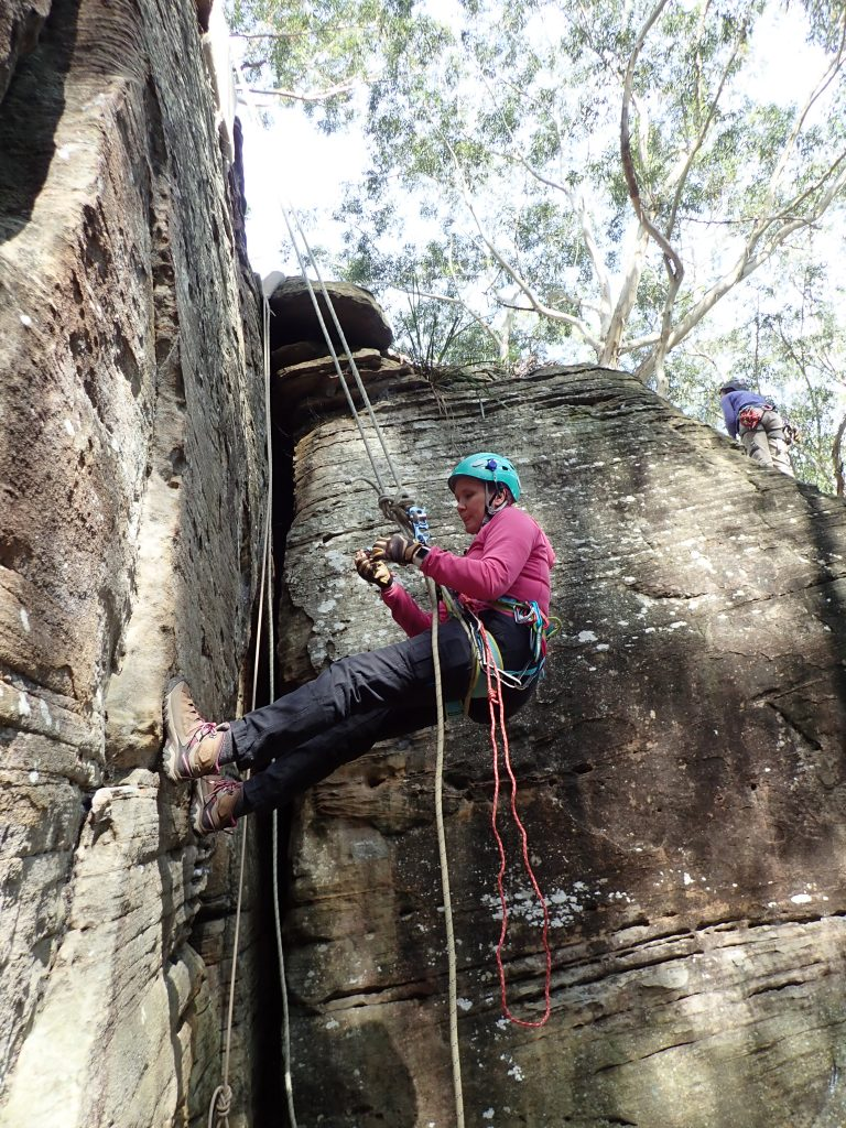 A Scout Leader performs a self rescue on an abseil in a training exercise at Lindfield Rocks
